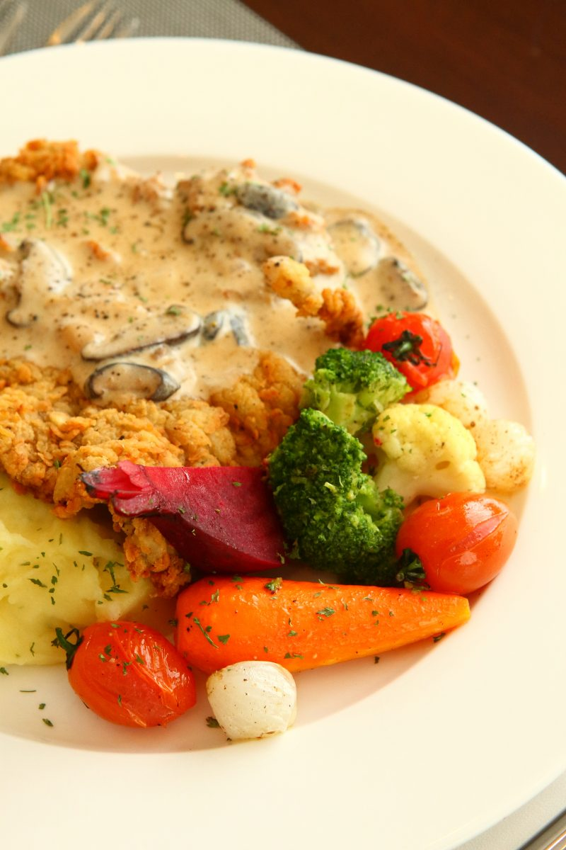 Cafe Rizal's Country Fried Steak served with mashed potatoes and grilled vegetables. Photo by Jovel Lorenzo.